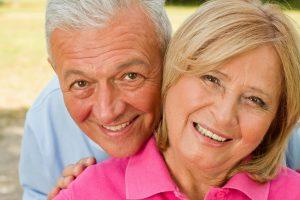 A smiling elder couple, probate living trust